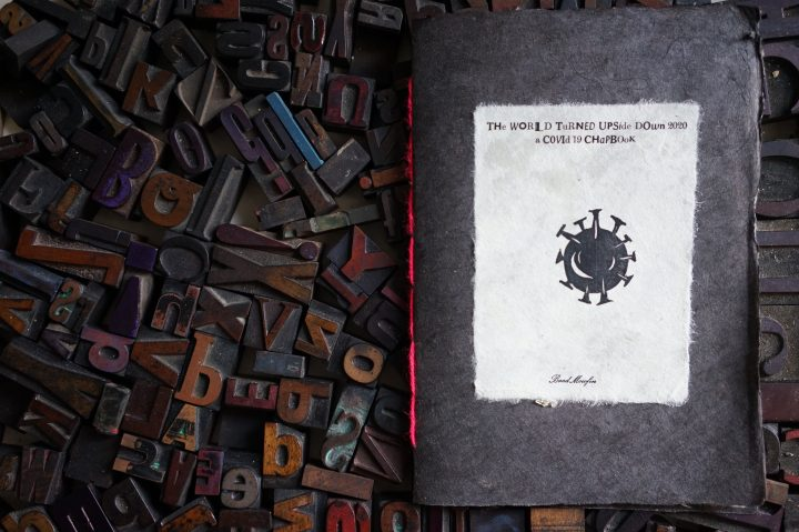 Image of the chapbook on a bed of woodtype.